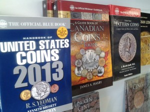 Coin and stamp supplies including coin reference books