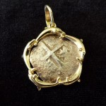 Colonial Spain 2 Reales with a 14 carat gold bezel